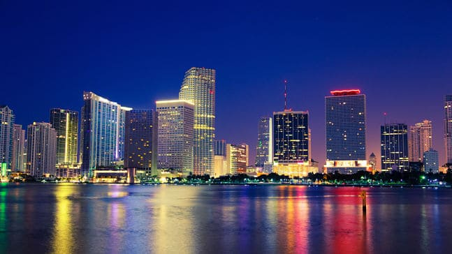 Miami city skyline at night, Miami Interpreter Services